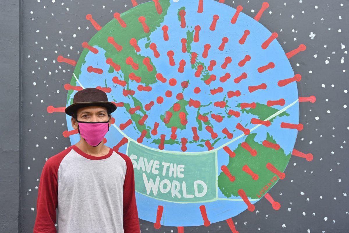 En Indonesia, pinturas y dibujos murales para combatir el coronavirus